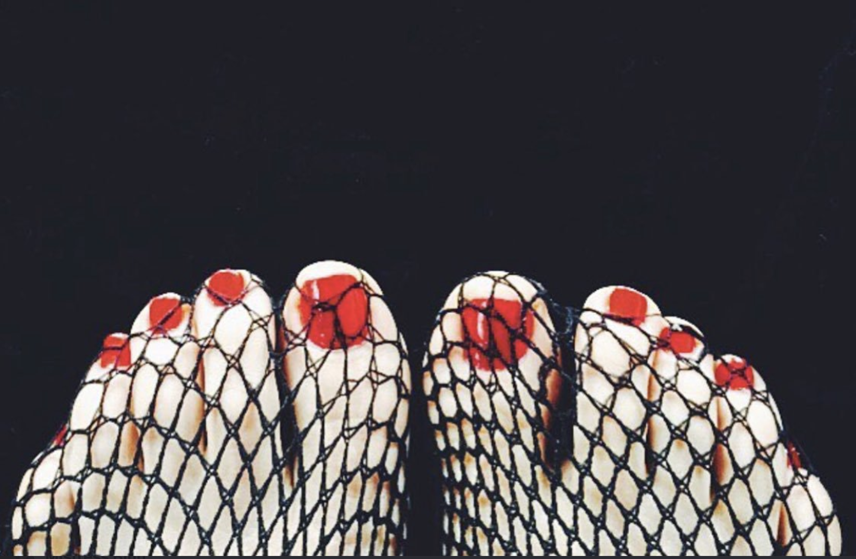 Mistress Blunt's perfect feet in fishnet foot fetish